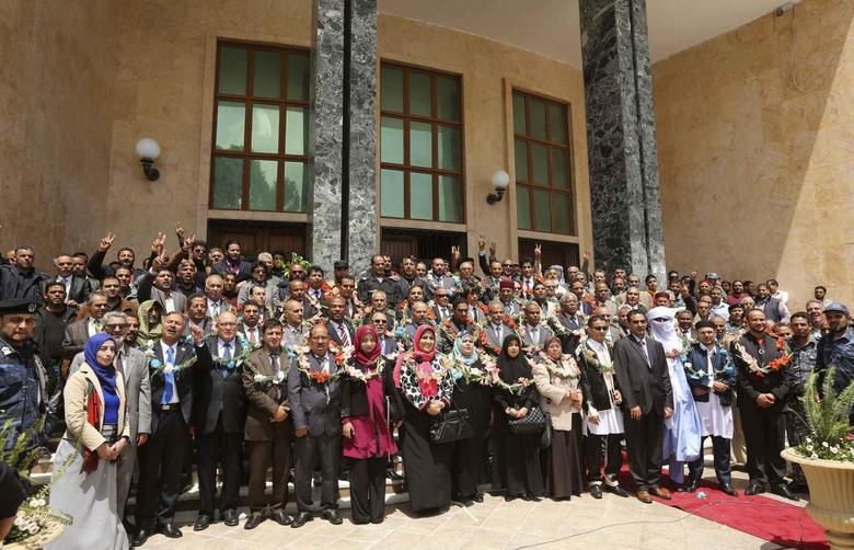 Members of the Constituent body drafting the new Libyan constitution pose for a group photograph at the entrance to the parliament hall in Al-Bayda, April 21, 2014. REUTERS/Esam Omran Al-Fetori