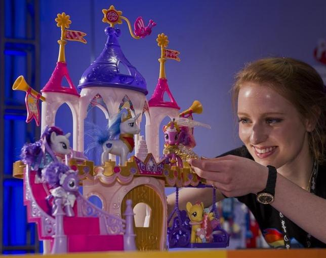 Toy demonstrator Christa Sparks shows off the new ''My Little Pony Pony Princess Wedding Castle'' playset, part of a new line of wedding-themed items shown at Hasbro's American International Toy Fair showroom in New York, February 11, 2012. REUTERS/Ray Stubblebine/Hasbro/Handout