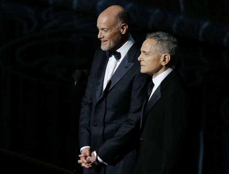 Craig Zadan and Neil Meron, Academy Award Producers, look on at the 86th Academy Awards in Hollywood, California March 2, 2014. REUTERS/Lucy Nicholson