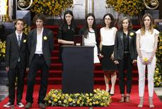 The grandchildren and other relatives of Colombian Nobel laureate Gabriel Garcia Marquez stand around the urn containing his ashes for public viewing, in the Palace of Fine Arts in Mexico City, April 21, 2014. REUTERS/Edgard Garrido