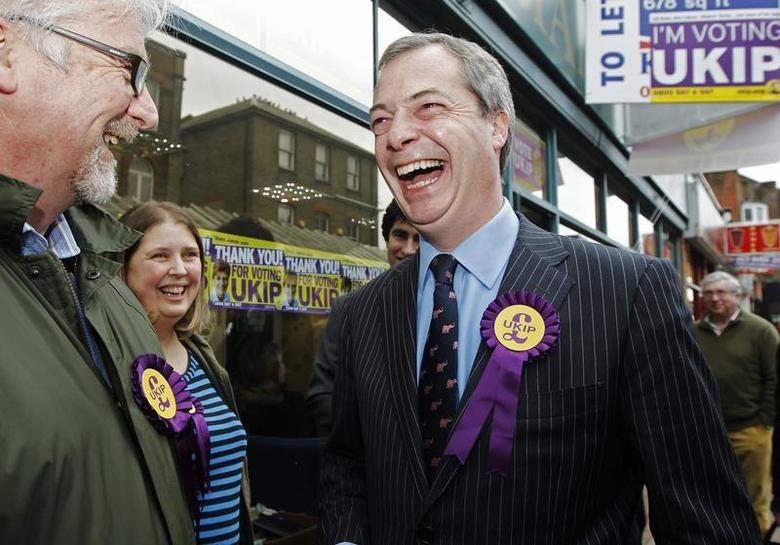 UK Independence Party (UKIP) leader Nigel Farage (R) thanks campaigners as he leaves the UKIP campaign office in Eastleigh, southern England March 1, 2013. REUTERS/Luke MacGregor