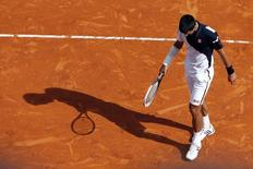 Novak Djokovic of Serbia reacts after missing a point during his match against Roger Federer of Switzerland during their semi-final match at the Monte Carlo Masters in Monaco April 19, 2014. REUTERS/Eric Gaillard