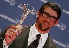 U.S. Olympic swimmer Michael Phelps poses with his Special Laureus Award during the 2013 Laureus World Sports Awards, at Municipal Theater in Rio de Janeiro March 11, 2013. REUTERS/Sergio Moraes