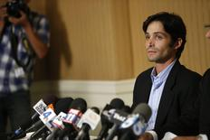 Plaintiff Michael Egan attends a news conference at the Four Seasons Hotel in Los Angeles, California April 17, 2014. REUTERS/Mario Anzuoni