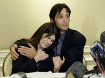 Michael Egan (R), who sued filmmaker Bryan Singer for allegedly raping him as a teenager, comforts his mother Bonnie Mound during a news conference at a hotel in Los Angeles April 21, 2014. REUTERS/Kevork Djansezian