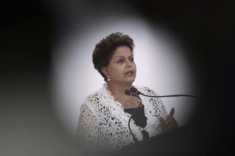 Brazil's President Dilma Rousseff speaks during a ceremony to sign concession contracts for duplication of highways in several Brazilian states, at the Planalto Palace in Brasilia March 12, 2014. REUTERS/Ueslei Marcelino