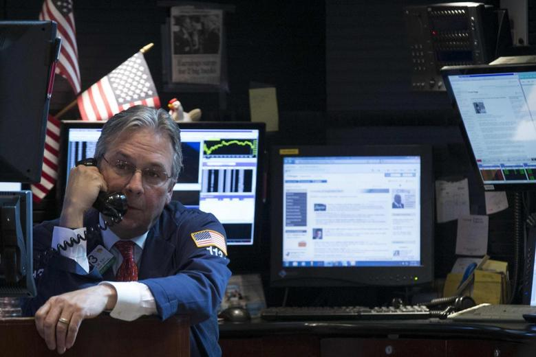 A trader works on the floor of the New York Stock Exchange April 21, 2014. REUTERS/Brendan McDermid