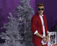 """Singer Justin Bieber poses at the premiere of the documentary """"Justin Bieber's Believe"""" in Los Angeles, California December 18, 2013. REUTERS/Mario Anzuoni"""