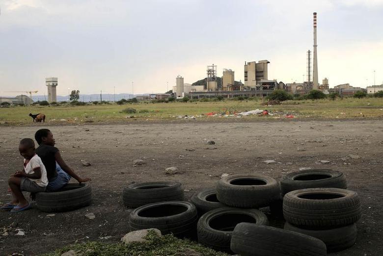 Children play on second-hand tyres outside Lonmin Mine at Marikana's Ikaneng township in Rustenburg, northwest of Johannesburg, January 24, 2014. REUTERS/Siphiwe Sibeko
