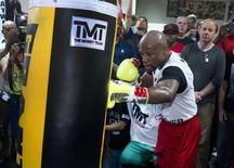 World Boxing Council (WBC) welterweight champion Floyd Mayweather Jr. of the U.S. hits a punching bag during a media workout at the Mayweather Boxing Club in Las Vegas, Nevada April 22, 2014. REUTERS/Steve Marcus