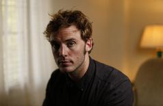 "British actor Sam Claflin poses for a portrait while promoting his upcoming movie ""The Quiet Ones"" at Chateau Marmont in West Hollywood, California April 22, 2014. REUTERS/Mario Anzuoni"