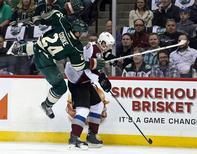 Apr 21, 2014; Saint Paul, MN, USA; Minnesota Wild forward Matt Cooke (24) hits Colorado Avalanche defenseman Nick Holden (2) during the first period in game three of the first round of the 2014 Stanley Cup Playoffs at Xcel Energy Center. Mandatory Credit: Brace Hemmelgarn-USA TODAY Sports -