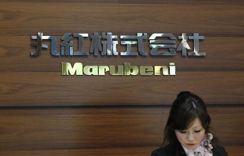 A receptionist works in front of the logo of Japanese trading house Marubeni Corp at the company's headquarters in Tokyo May 29, 2012. REUTERS/Yuriko Nakao