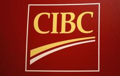 The CIBC logo is seen on the trading floor during the CIBC Miracle Day charity event in New York December 4, 2013. REUTERS/Shannon Stapleton