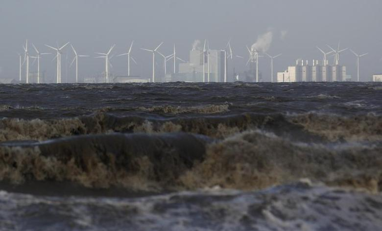 Wind turbines are pictured near the town of Emden, December 6, 2013. REUTERS/Ina Fassbender