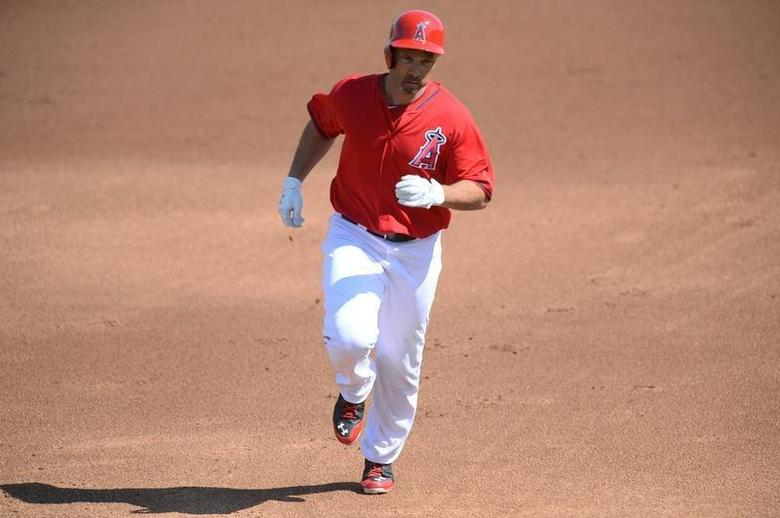Mar 4, 2014; Tempe, AZ, USA; Los Angeles Angels outfielder Raul Ibanez runs the bases after hitting a home run against the Texas Rangers during a spring training game at Tempe Diablo Stadium. Mandatory Credit: Joe Camporeale-USA TODAY Sports - RTR3G1LR