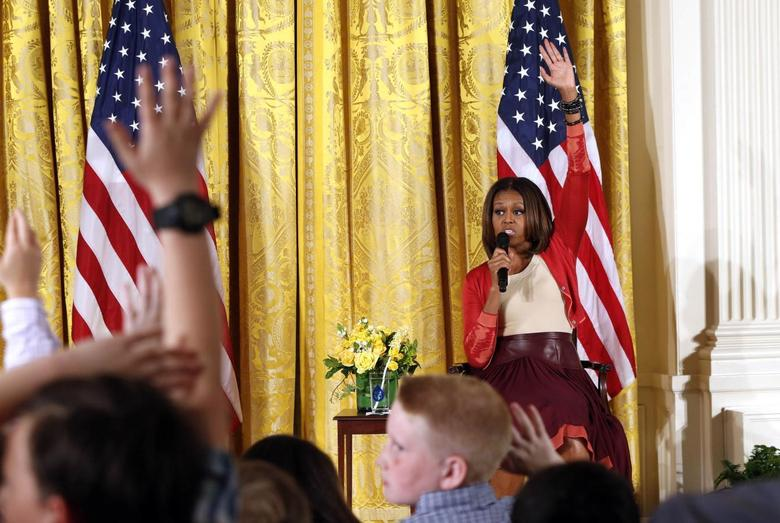 U.S. first lady Michelle Obama takes questions wile speaking with children of Executive Office employees at the White House's annual Take Our Daughters and Sons to Work Day in Washington April 24, 2014. REUTERS/Kevin Lamarque