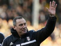 Fulham's head coach Rene Meulensteen waves before their English Premier League soccer match against Swansea City at Craven Cottage in London November 23, 2013. REUTERS/Stefan Wermuth
