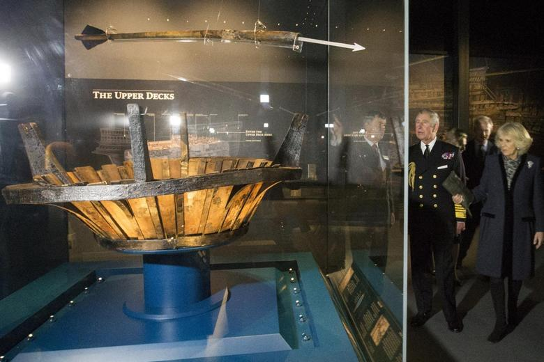 Britain's Prince Charles looks at artefacts during his visit with Camilla, Duchess of Cornwall, to the Mary Rose Museum in Portsmouth, southern England February 26, 2014. REUTERS/Dan Kitwood/pool