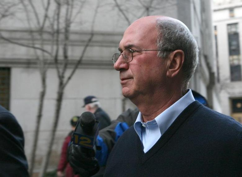 Accused money manager Stephen Walsh leaves the United States Federal Courthouse in New York February 25, 2009. REUTERS/Brendan McDermid