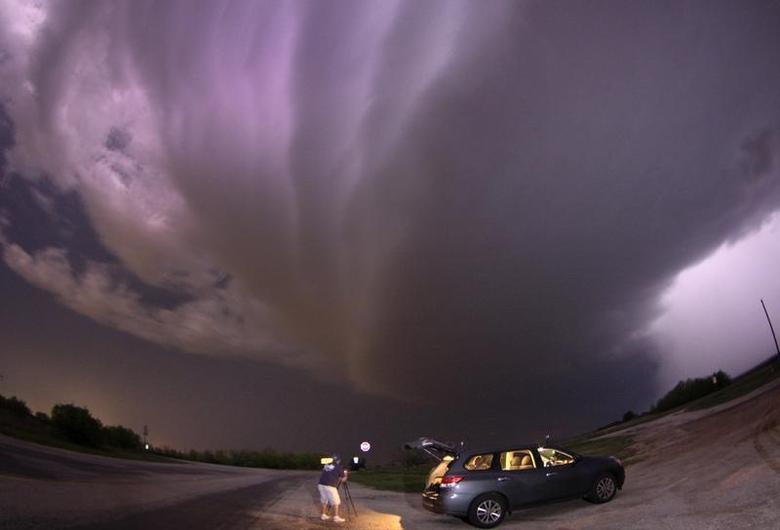 A large TVS (tornadic vortex signature) thunderstorm supercell passes over storm chaser Brad Mack in Graham, Texas late April 23, 2014. REUTERS/Gene Blevins