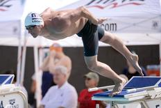 Apr 24, 2014; Mesa, AZ, USA; Ryan Lochte swims during the men's 100m freestyle event at Skyline Aquatic Center. Joe Camporeale-USA TODAY Sports