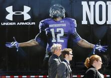 Officials from the National Labor Relations Board leave the Northwestern University campus after football players voted to determine if athletes want to form a union in Evanston, Illinois, April 25, 2014. REUTERS/Jim Young