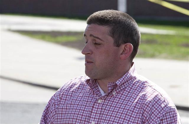 Ed Kovac, the cousin of slain student Maren Sanchez, addresses the media in front of Jonathan Law High School in Milford, Connecticut April 25, 2014. REUTERS/Michelle McLoughlin