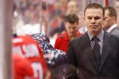 Nov 20, 2013; Washington, DC, USA; Washington Capitals head coach Adam Oates looks on from behind the bench against the Pittsburgh Penguins in the second period at Verizon Center. The Penguins won 4-0. Mandatory Credit: Geoff Burke-USA TODAY Sports - RTX15MKQ