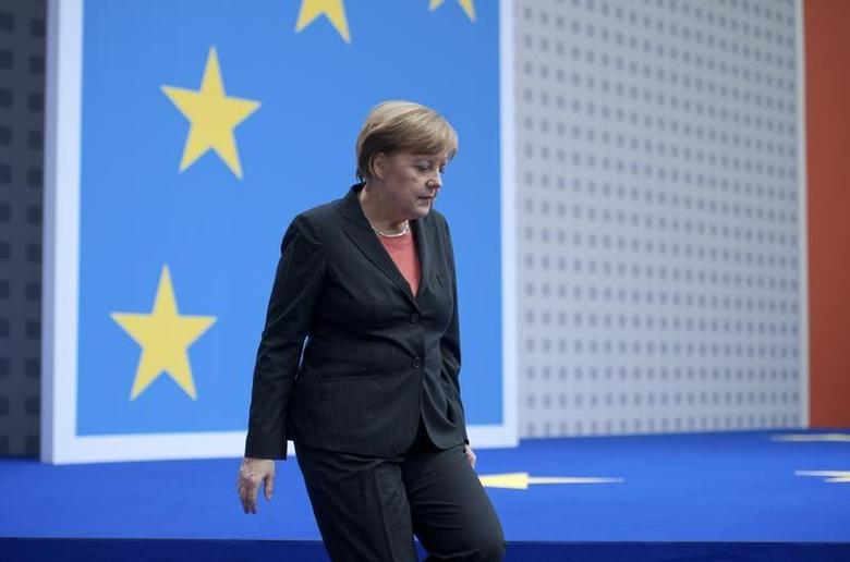 German Chancellor Angela Merkel, leader of the Christian Democratic Union (CDU), leaves the stage after her speech during the CDU congress in Berlin April 5, 2014. REUTERS/Stefanie Loos