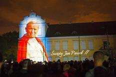 An image of Pope John Paul II is projected during a multimedia show a night before his canonization, in Krakow April 26, 2014. REUTERS/Agencja Gazeta/Jacek Smoter