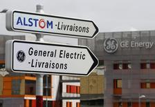 Road signs indicate directions for deliveries to French power and transport engineering company Alstom and U.S. conglomerate General Electric sites in Belfort, April 27, 2014. REUTERS/Vincent Kessler