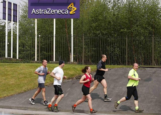 Runners jog past an AstraZeneca site in Macclesfield, central England April 28, 2014. REUTERS/Darren Staples