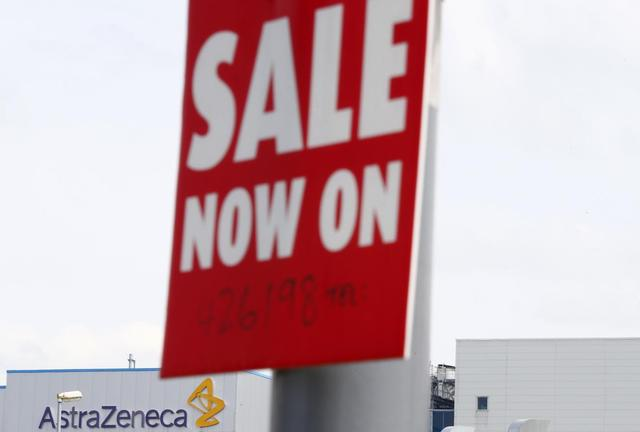 A sale sign hangs near an AstraZeneca site in Macclesfield, central England April 28, 2014. REUTERS/Darren Staples