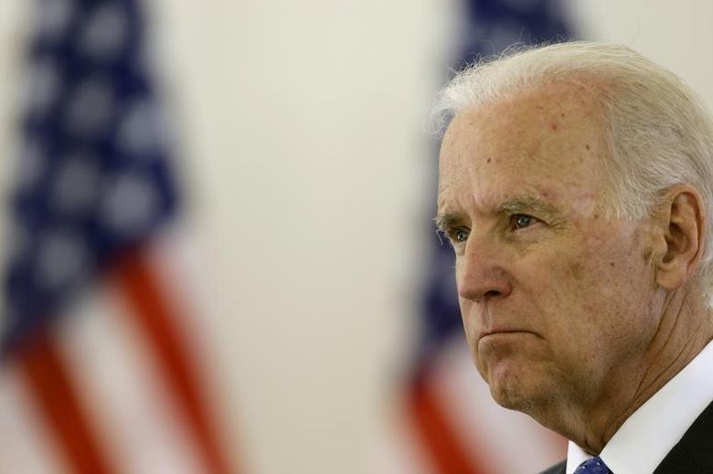 U.S. Vice President Joe Biden listens during a news conference in Vilnius March 19, 2014. REUTERS/Ints Kalnins