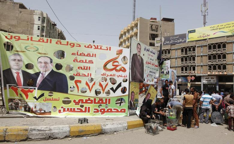 An election poster of Mahmoud Al-Hassan of Prime Minister Nuri al-Maliki's State of Law coalition is displayed along a street at the start of the election campaign in Baghdad April 18, 2014. Iraq is holding its national election at the end of this month. REUTERS/Ahmed Saad