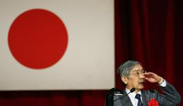 Bank of Japan Governor Haruhiko Kuroda gestures as he speaks during a seminar in Tokyo March 20, 2014. REUTERS/Yuya Shino