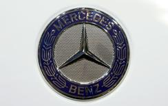 The company logo is seen on the bonnet of a Mercedes Benz car during the media day ahead of the 84th Geneva Motor Show at the Palexpo Arena in Geneva March 5, 2014. REUTERS/Arnd Wiegmann