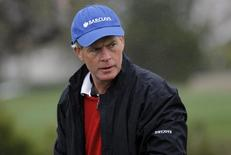 """CEO of Barclays Americas Hugh """"Skip"""" McGee III dons a rain jacket during the second round of the Pebble Beach National Pro-Am golf tournament at the Monterey Peninsula Country Club in Pebble Beach, California, February 7, 2014. REUTERS/Michael Fiala"""