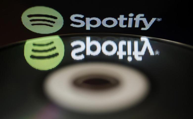 The logo of online music streaming service Spotify is reflected in an audio music CD in this illustration picture taken in Strasbourg, February 18, 2014. REUTERS/Vincent Kessler