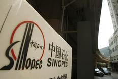A Sinopec logo is displayed at one of its gas stations in Hong Kong March 26, 2010. REUTERS/Bobby Yip