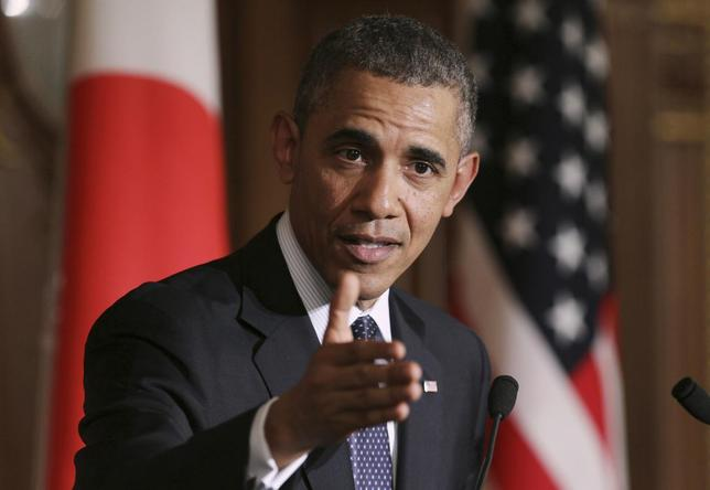 U.S. President Barack Obama gestures during a news conference with Japanese Prime Minister Shinzo Abe (not seen) at the Akasaka guesthouse in Tokyo April 24, 2014. REUTERS/Junko Kimura-Matsumoto/Pool