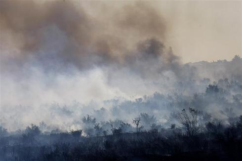Firefighters hold line against fierce Southern California wildfire