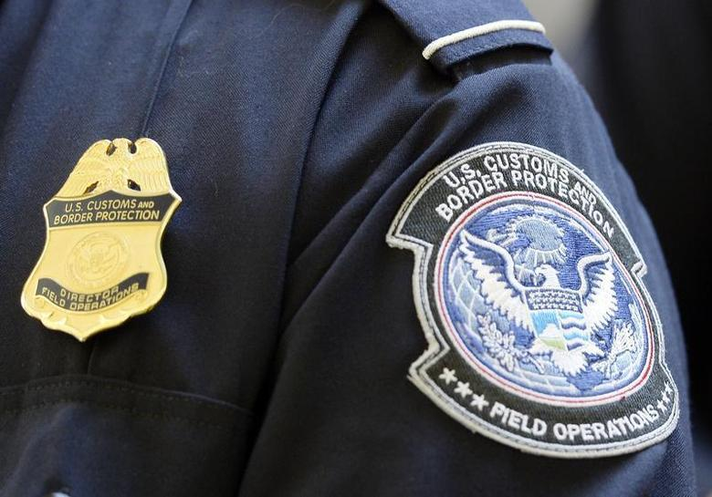 A U.S. Customs and Border Protection arm patch and badge is seen at Los Angeles International Airport, California February 20, 2014. REUTERS/Kevork Djansezian