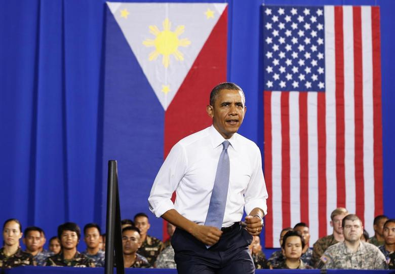 U.S. President Barack Obama walks out to speak to military troops at the Fort Bonifacio Gymnasium in Manila, April 29, 2014. Obama said a new military pact signed with the Philippines on Monday granting a larger presence for U.S. forces would bolster the Southeast Asian country's maritime security, but was not aimed at countering China's growing military might. REUTERS/Larry Downing