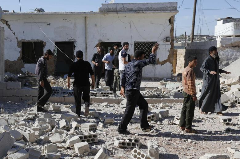 Car bombs in central Syria kill 18: state TV