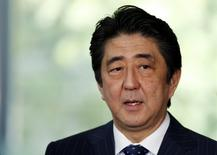 Japan's Prime Minister Shinzo Abe speaks to the media at his official residence after Japan and the U.S. issued a joint statement in Tokyo April 25, 2014. REUTERS/Toru Hanai