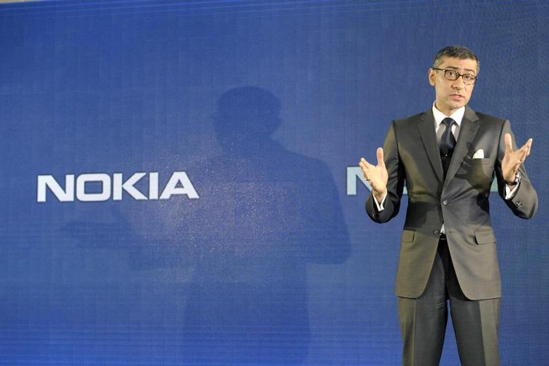 Nokia CEO Rajeev Suri speaks during a news conference to announce its first quarter earnings in Espoo April 29, 2014. REUTERS/Heikki Saukkomaa/Lehtikuva