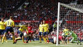 Patrice Evra (C) of Manchester United's header is saved by Sunderland's goal keeper Vito Mannone during their English Premier League soccer match at Old Trafford in Manchester, May 3, 2014.   REUTERS/Darren Staples (BRITAIN