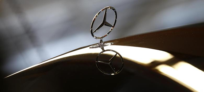 An emblem of German car Mercedes-Benz is pictured at the production line of the Mercedes-Benz S-class in Sindelfingen near Stuttgart January 24, 2014. REUTERS/Michaela Rehle